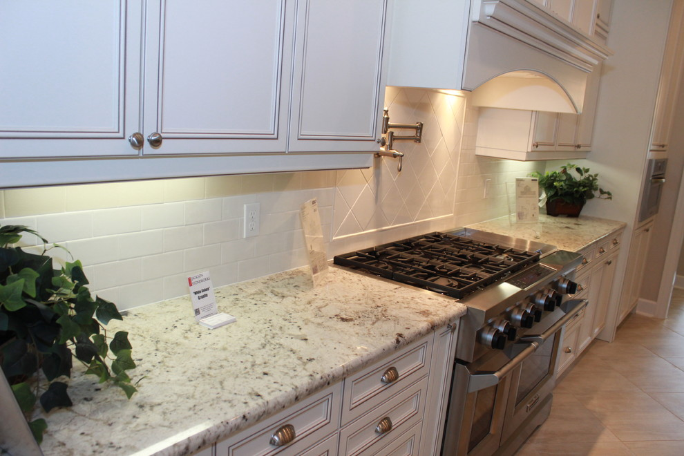Granite Sandstone Countertop With Tan Cabinet Kitchen Design Ideas